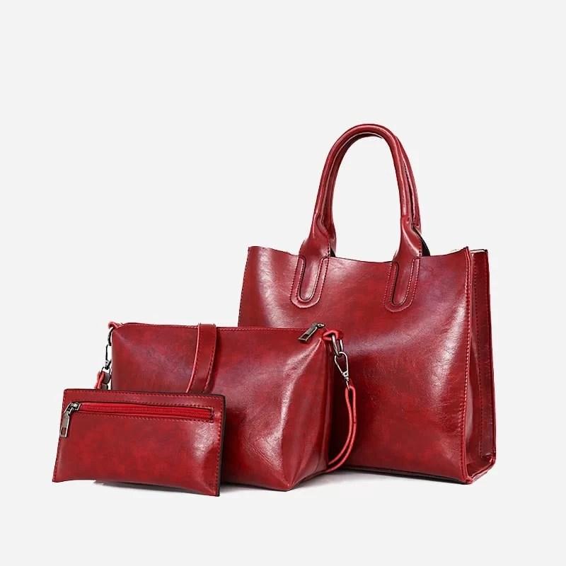 Set de sacs pour femme en cuir rouge. Sac à main., sac bandoulière et pochette.