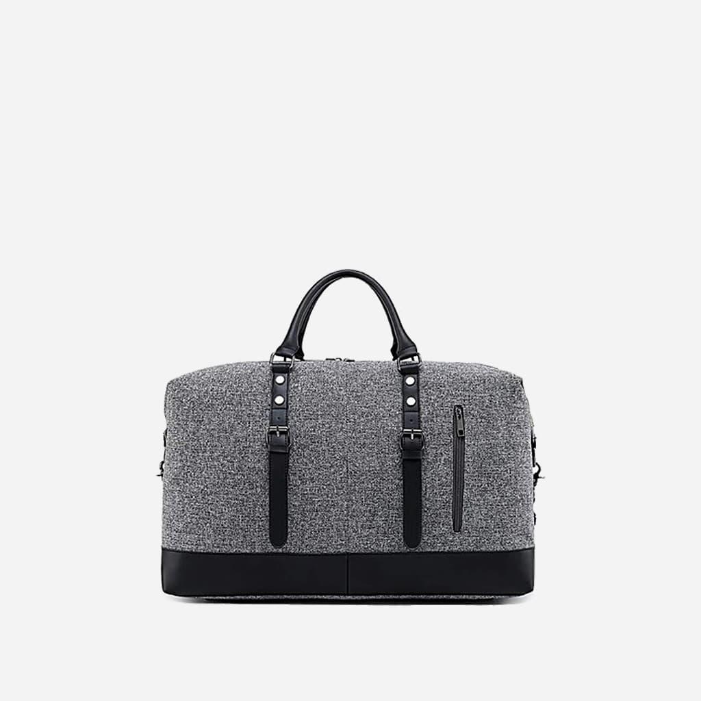 Grand sac de voyage 48h en toile de tissus et en cuir gris et noir.