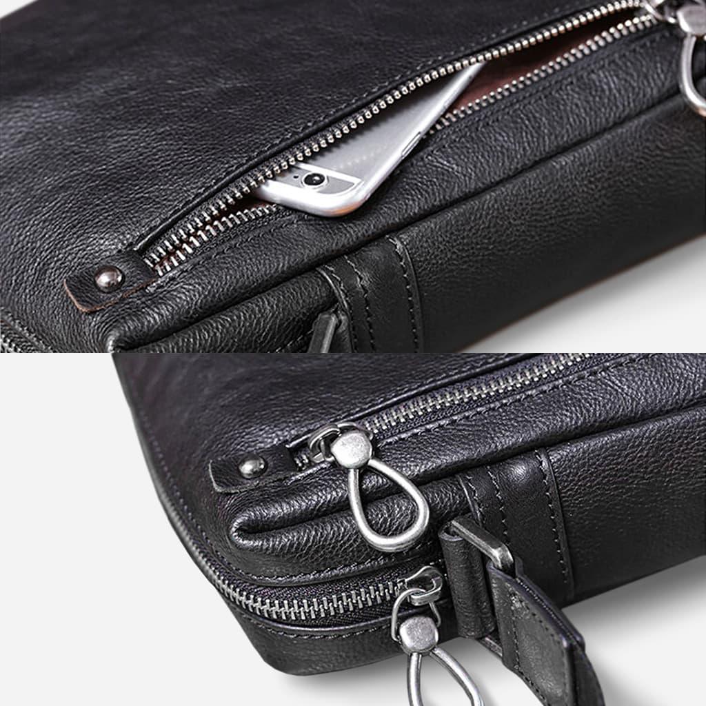 Détails des poches et des fermetures de la petite sacoche homme en cuir véritable noir.