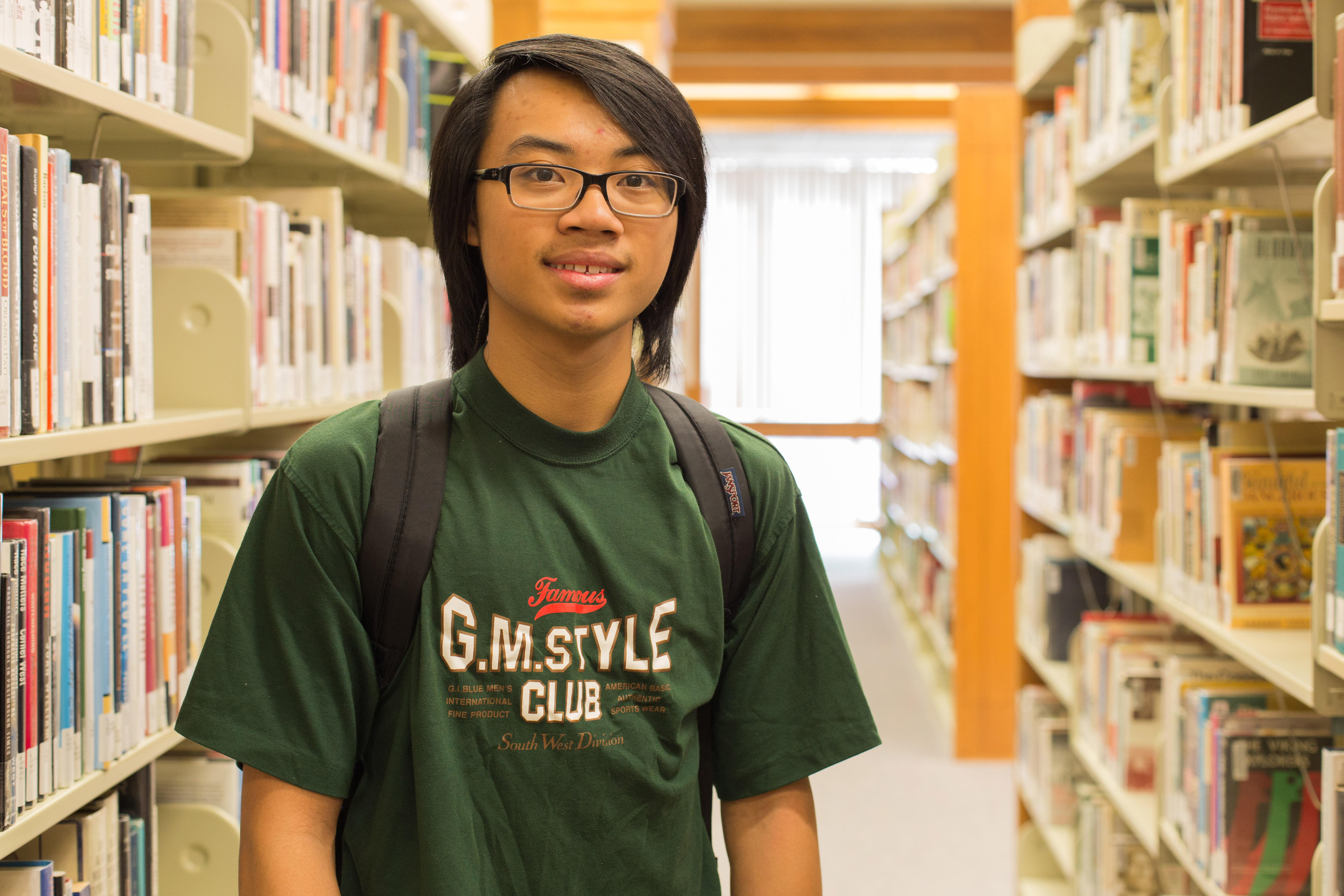 City College Student Eric Ngai Biochemistry Major Poses For A Photo In The Library April 27 2016 Hector Flores Staff Photographer