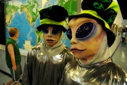Resident aliens pose for photos Thursday, July 2, 2009 at the International UFO Museum and Research Center in Roswell, N.M., on the first day of the UFO Festival. (AP Photo/Roswell Daily Record Mark Wilson)