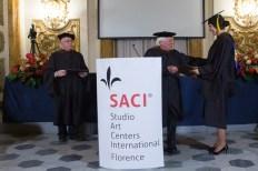 SACI Founder and Director Emeritus, Jules Maidoff, giving MFA diplomas