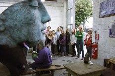 SACI sculpture students visiting a casting studio in Carrara