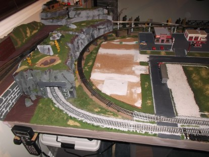 The ballast is finished for now. The parking lot for the park is also in place.