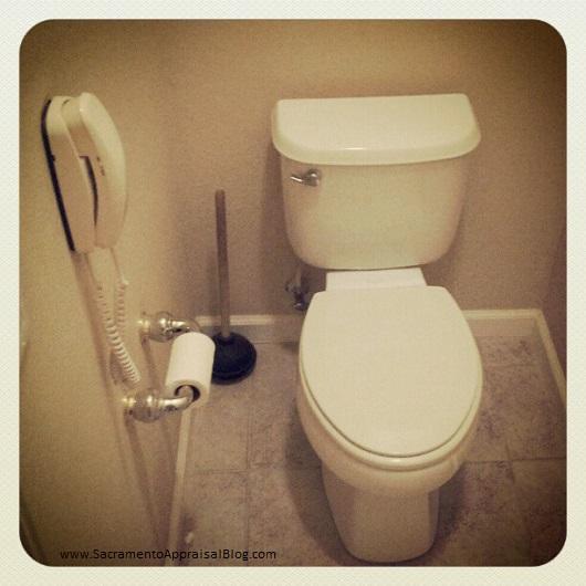 photo of phone in bathroom - by Sacramento Appraisal Blog