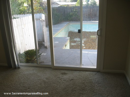 view from bedroom with pool in front yard - sacramento appraisal blog