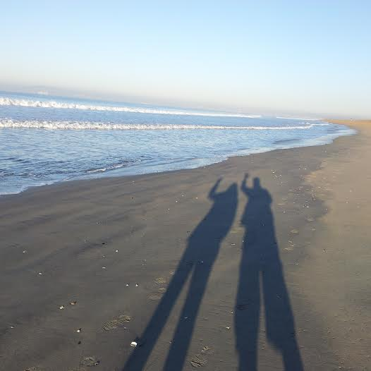 two people on beach - by sacramento appraisal blog