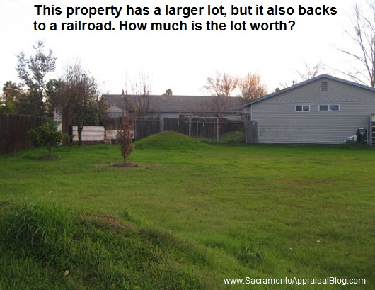 larger lot backs railroad - sacramento appraisal blog