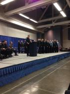 Captain Davis congratulating the new officers