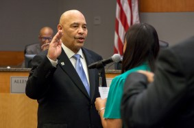 Newly elected Council Member Larry Carr is sworn into office.