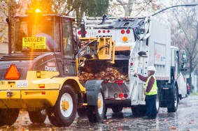 Leaf pickup crew work hard as Sacramento is hit with minor storm.