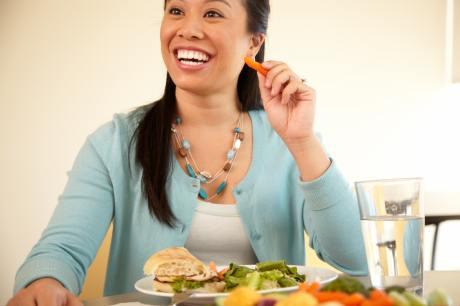 Woman eating salad_brand photo