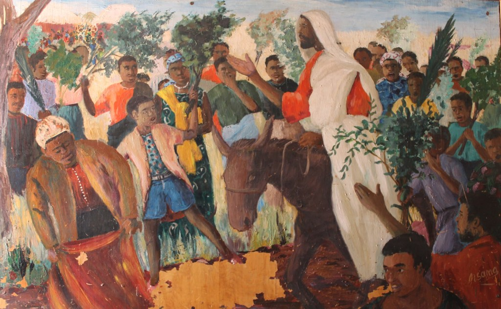 Palm Sunday An_African_Jesus_Christ_s_triumphal_entry_into_Jerusalem_riding_on_a_donkey_to_the_enthusiasm_of_the_crowds