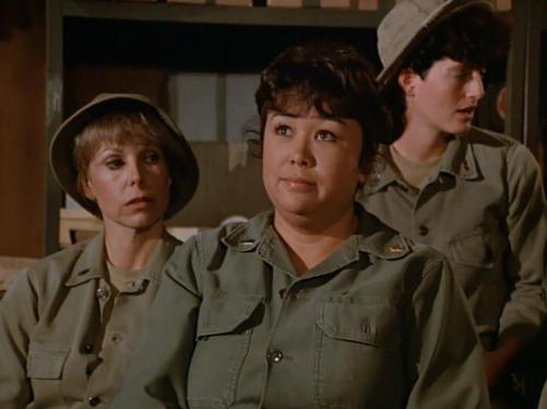 Nurse Kellye, played by Kellye Nakahara.