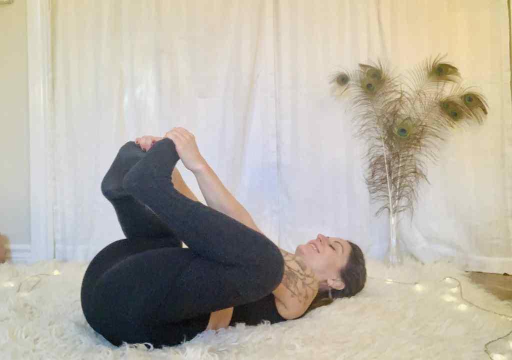 Happy Baby Yoga Pose - Ananda Balasana on shaggy carpet
