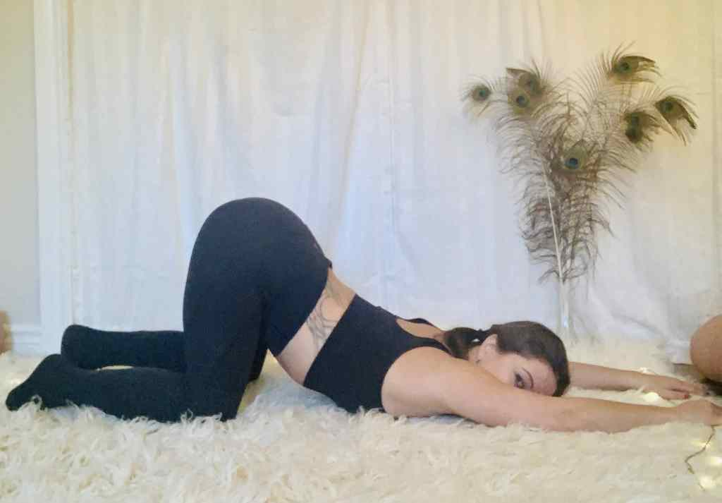 Heart opening Yoga Pose - Anahatasana on shaggy carpet