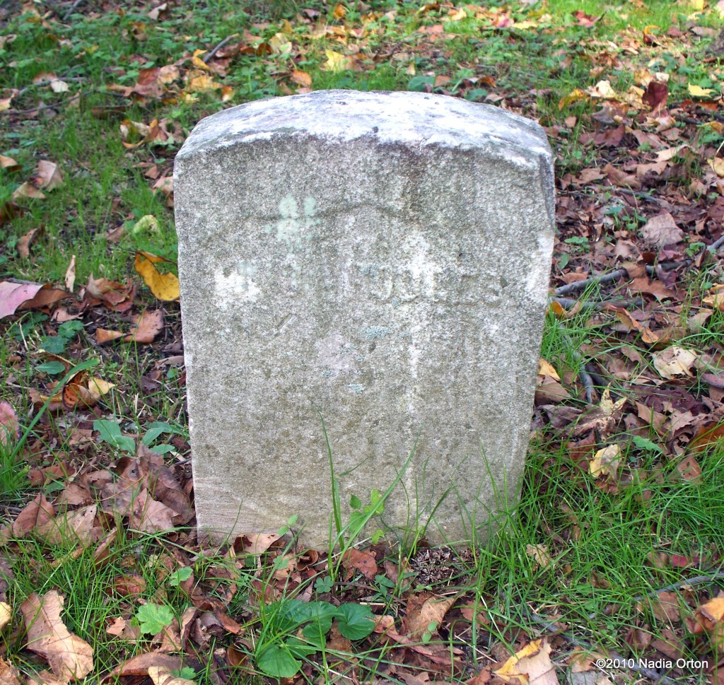 A picture of the old gravestone.