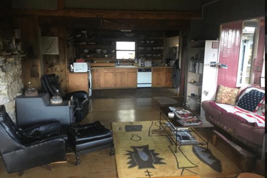 Open kitchen & lounge area around wood-burning stove