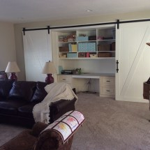 Home remodeling project featuring built-in book cases and sliding wooden doors