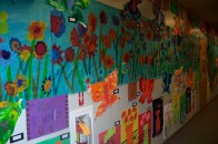 Mrs. Newell's class flower mural with Kindergarten Flowers and First grade vases