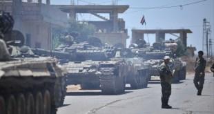 قوات النظام في قرية الغارية الغربية بمحافظة درعا - رويترز