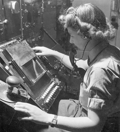 WAAF radar operator Denise Miley plotting aircraft on a cathode ray tube in the Receiver Room at Bawdsey 'Chain Home' station, May1945.