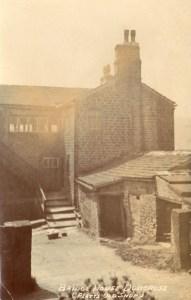 Platt's first workshop on the right at Bridge House, Dobcross c1905