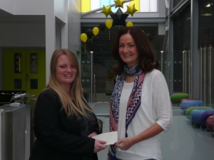 GRATEFUL: Claire Crossfield (left) receives a cheque from Lucy Cobb