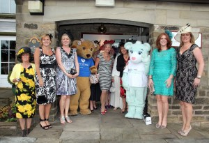 ALL SMILES: Revellers at the White Hart with Gill Bussey, centre, joined by bears from The Christies Allsorts and Dr Kershaw's Hospice