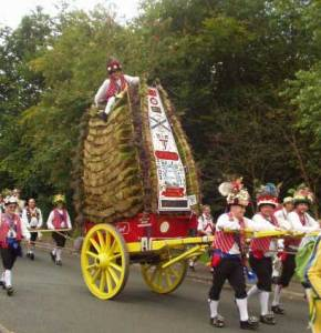 FESTIVAL: Morris Men pull the rushcart with the 'jockey' on top