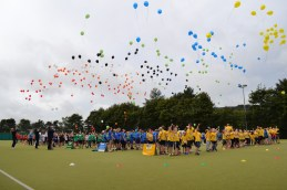 Children release their balloons into the sky