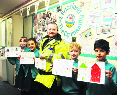 Friezland Primary School Year 6 pupil Millie Meredith had her design chosen to be made into stickers, pictured with Haaris Mirza, Francis Butterworth and Libby Reynolds.