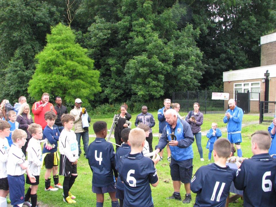 Max Lawton, honorary vice president, presenting Failsworth with the winners' trophy