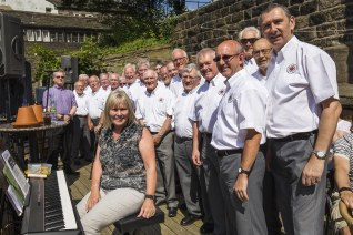 Louise Brennan and the Saddleworth male voice choir before their performance at the Hare & Hounds, Uppermill