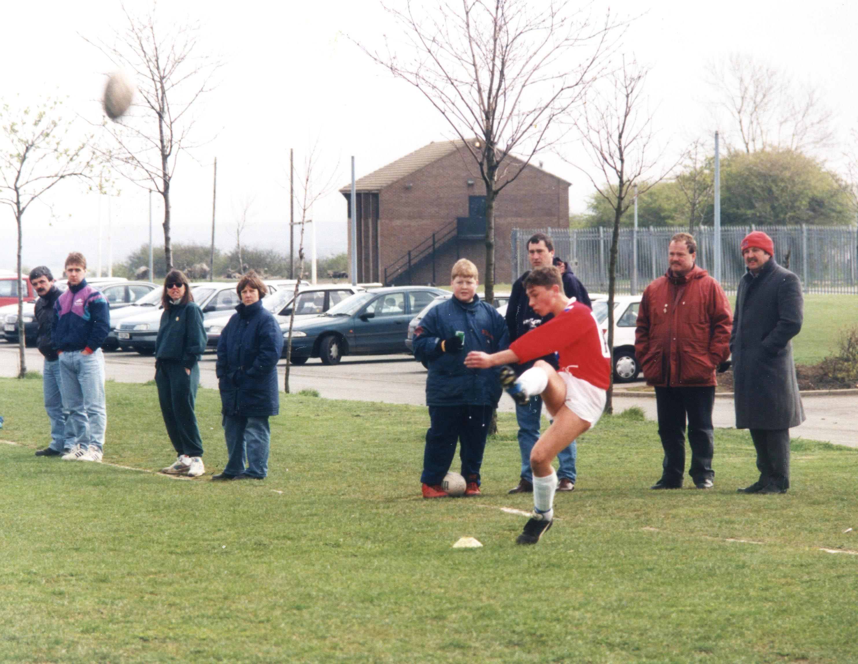 Kevin gets in some kicking practise as a schoolboy