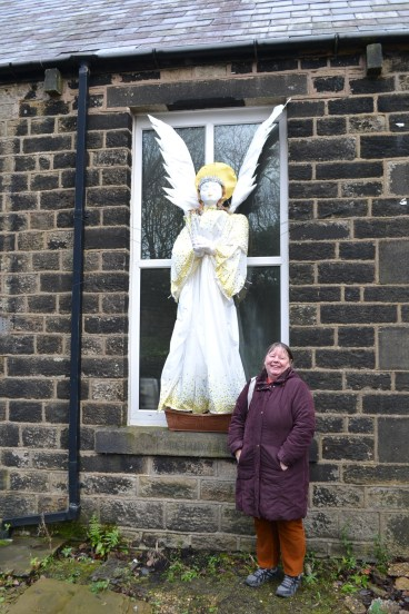Janet Iles by her angel at Kilngreen