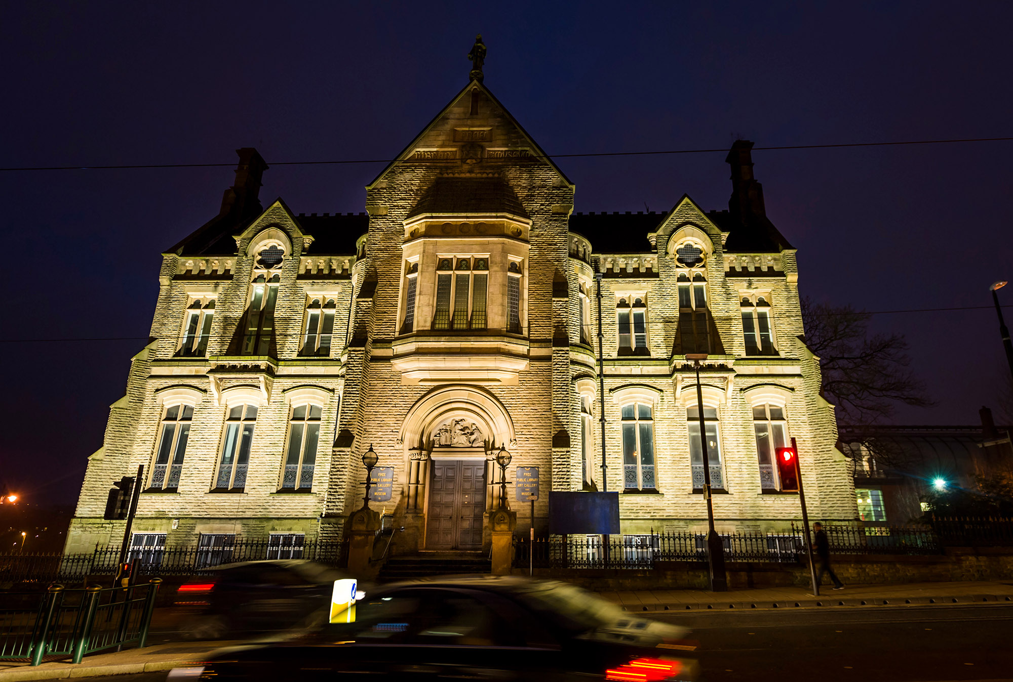 The former library building as it looks in 2016 – illuminated at night