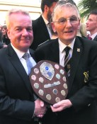 Musical Director Dean Redfern and Band Chairman John Ward with the trophy