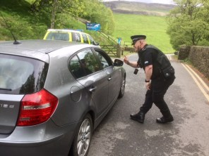 PC Lee Cullen stops drivers at the entrance to Dovestones reservoir issuing leaflets with parking assistance and bbq warning