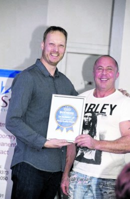 Paul's Quality Meats receive their award from Richard