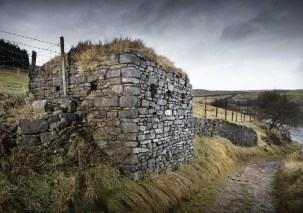 Listing 2020.World War 2 pillbox overlooking A62 (Huddersfield Rd), Bleak Hey Nook, Standedge, Delph, Saddleworth, Oldham,West Yorkshire.Listed Grade 2.Unusual design and construction with dry stone wall exterior walls and turfed roof giving the appearance of an agricultural vernacular building, camoflaging its real purpose. Exterior view from south west.