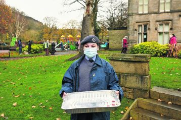 Grace handing out the cupcakes in Uppermill (Pic: David Whalley)
