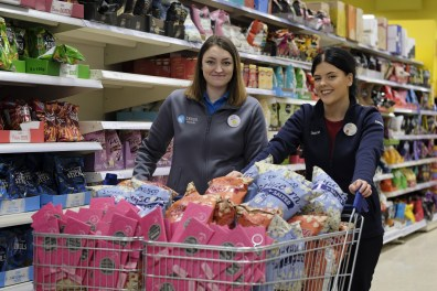 Tesco colleagues Elinor Hughes and Sophie Kelly getting snacks ready