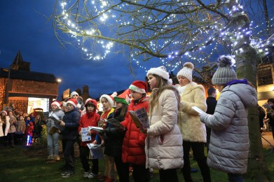 Children gather for the carols and switch on (Pictures by Carl Royle)