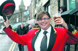 Dobcross Silver Bands Clare Fawcett holds her pint aloft to celebrate the 129th Whit Friday band contest at Uppermill