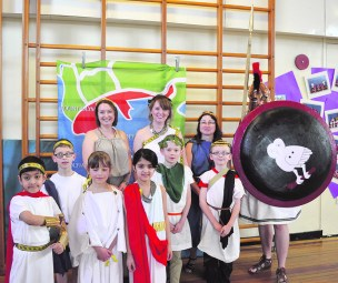 Pupils and staff with the Greek soldier