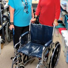 Connie Saiz and Kathleen Weiss ready medical equipment for loan.