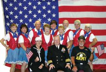 Pictured (from left, front) are Gina, Capt. Robert Stone and Gus; (from left, back) Pat Tiefenbach, Sylvia Bonesky, Dan Marsh, Stephanie Cady, Diane Korn, Pat Cox, Skip Brauns, Carol Jones and Donna Leonard.