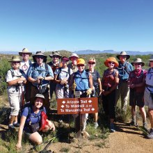On the Arizona National Scenic Trail in Oracle are, left to right, Janis and Norm Rechkemmer, Elaine (kneeling) and Howie Fagan, Ray Peale, Anne Hammond, Chris Swenson, Sandra Sowell, Mary Croft, Arlene Gerety, Jerry Morris, Rosemarie McGoldrick and Lissa White; photo by Elisabeth Wheeler.