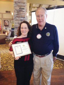 Neil Deppe presents Amy Reichgott a plaque in appreciation for her information about Western National Parks Association.